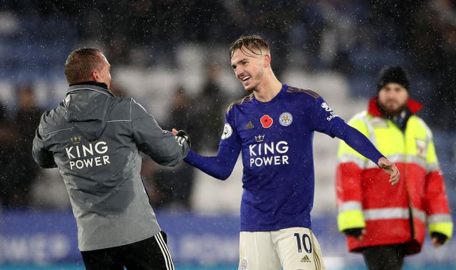 Leicester City's James Maddison (right) and manager Brendan Rodgers celebrate