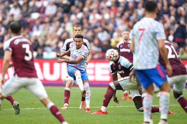 Jesse Lingard curls home the winning goal