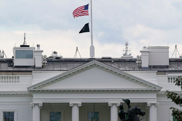 The American flag flies at half-mast over the White House in Washington (Susan Walsh/AP)