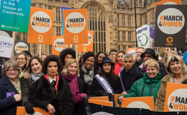 Marchers including (from third left to right) Bianca Jagger, Justine Greening, Natalie Imbruglia, Mayor of London Sadiq Khan and Sandi Toksvig, gather outside the Palace of Westminster, central London, ahead of the March4Women (Dominic Lipinski/PA)