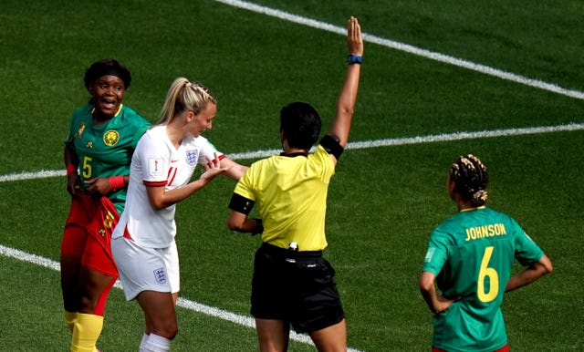 Toni Duggan complains to referee Qin Liang after her arm was spat on