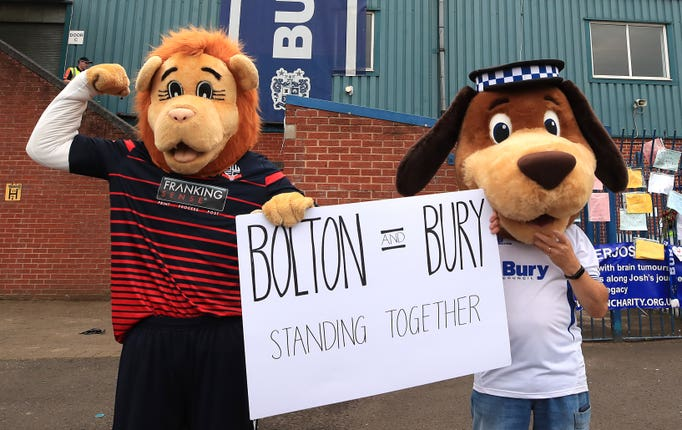 Bolton mascot Lofty the Lion (left) and Bury mascot Robbie the Bobby at Gigg Lane, Bury (Peter Byrne/PA)