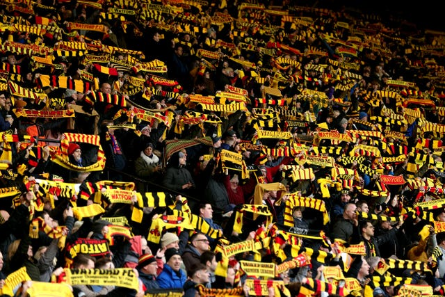 Watford fans show support for their team in the stands