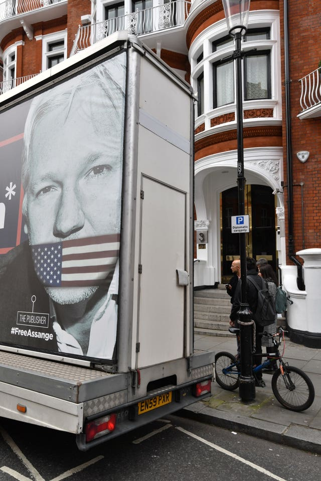 A poster showing Julian Assange gagged by an American flag