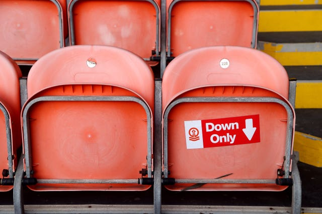 Signage at Blackpool's Bloomfield Road helps supporters abide by social distancing rules within the stadium
