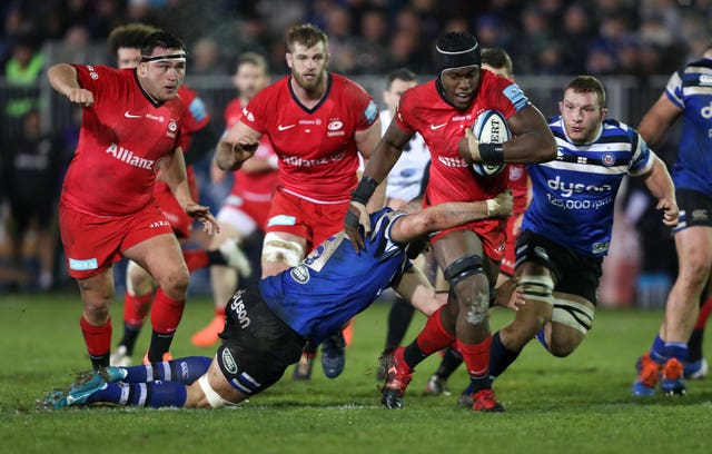 Maro Itoje, right, takes on the tackle of Bath's Elliott Stooke