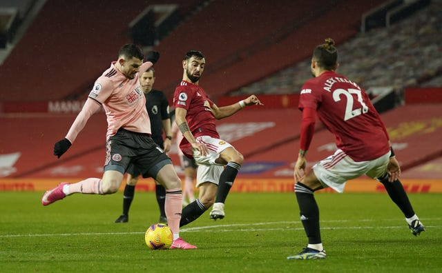 Substitute Oliver Burke fired Sheffield United to victory at Old Trafford on Wednesday