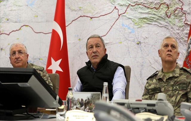 Turkey's defence minister Hulusi Akar, centre, in an operation room at army headquarters in Ankara