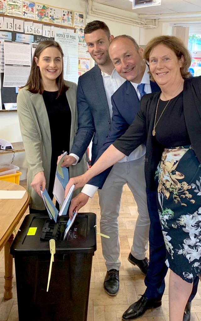 Fianna Fail leader Micheal Martin, voting with his wife Mary and their children Micheal A and Aoibhe