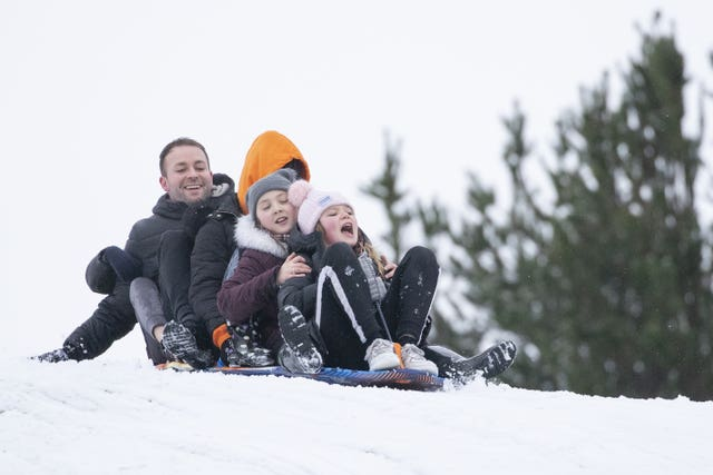 Left to right, Michael McInally, Katie Black, Rhea Black, 10, and Carmyn McInally, 10, sledging at Glencourse Golf Course near Penicuik, Midlothian