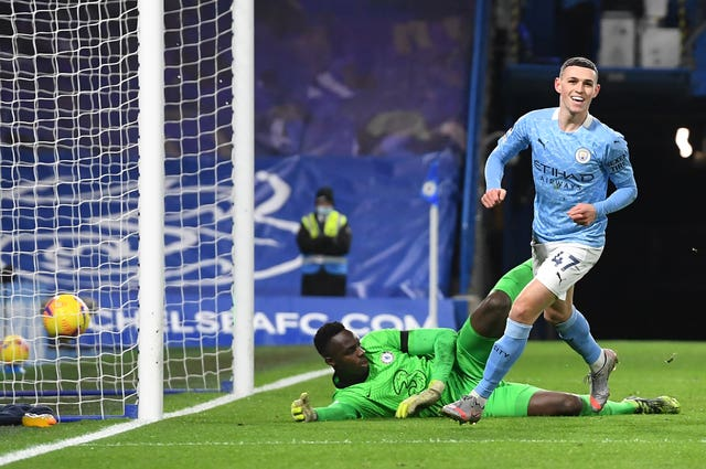 Phil Foden scores Manchester City's second goal during their 3-1 win at Chelsea