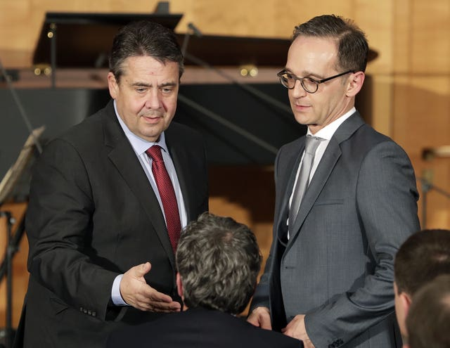 German Foreign Minister Heiko Maas, right, and his predecessor Sigmar Gabriel at a handing-over of office ceremony at the foreign ministry in Berlin (AP Photo/Michael Sohn)