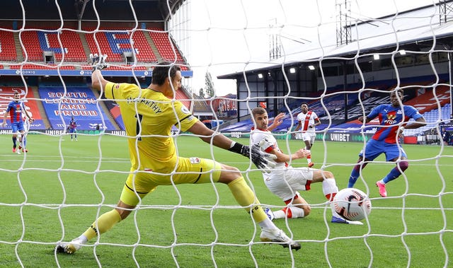 Wilfried Zaha, right, beats Southampton goalkeeper Alex McCarthy, left, to score the only goal of the game at Selhurst Park