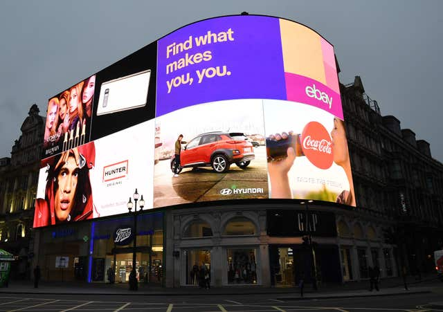 The advertising screens at Piccadilly Circus in central London are switched on for the first time in nine months after the electronic hoardings were replaced with a state-of-the-art screen measuring 790 square metres.