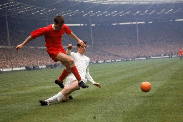Hunter, right, challenges Roger Hunt for the ball during the 1965 FA Cup final at Wembley