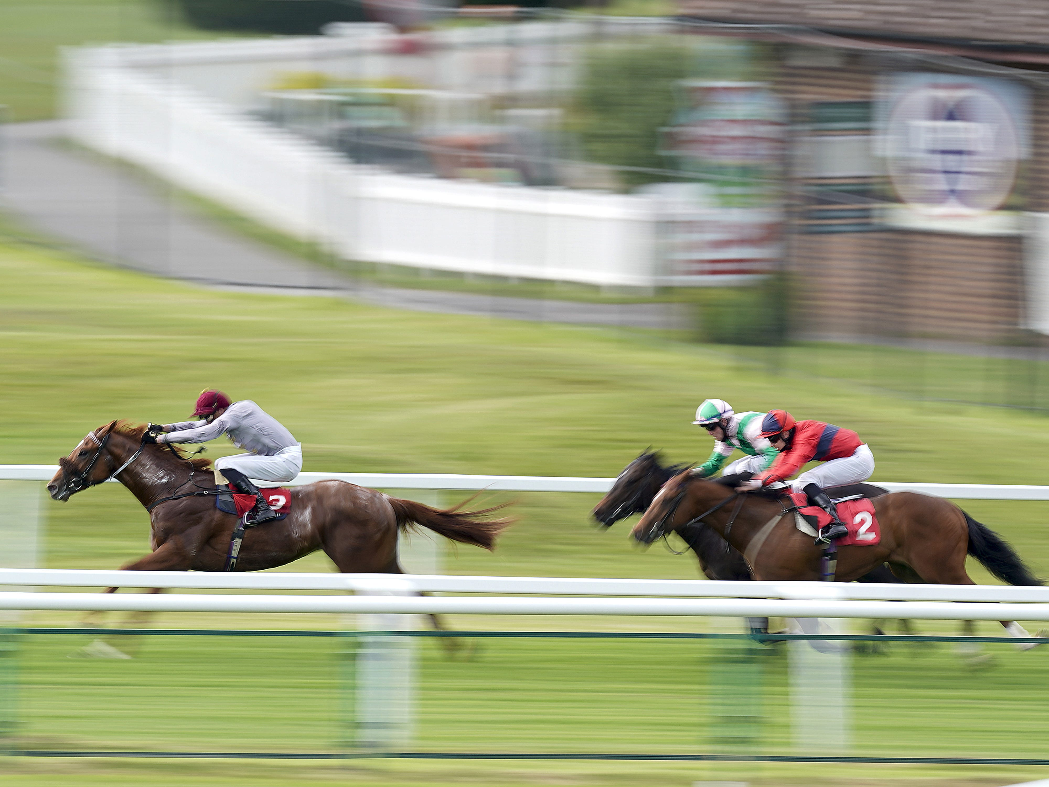 James Doyle riding Ebro River (left) coming home to win The Coral 'Beaten By A Length' National Stakes at Sandown Park Racecourse (Alan Crowhurst/PA)