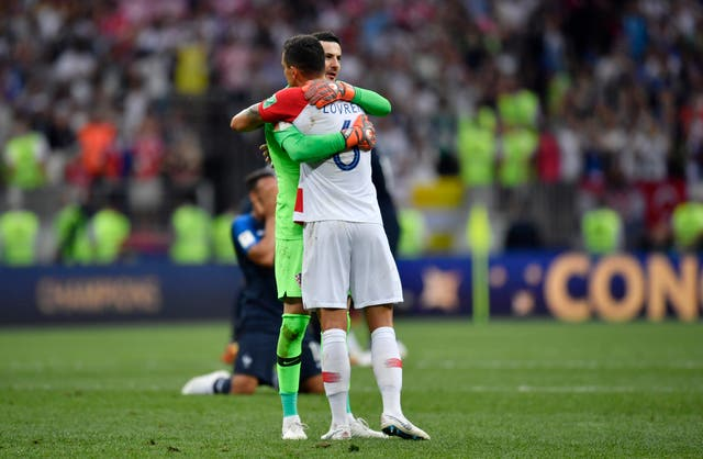 Lovren commiserates with Croatia goalkeeper Danijel Subasic