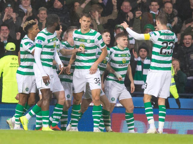 Celtic players celebrate the decisive goal