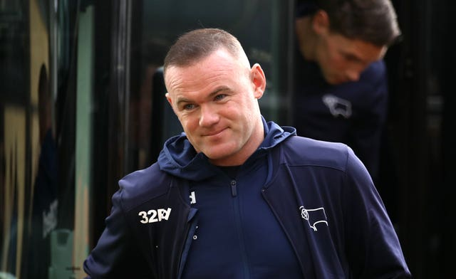 Rooney, in Derby coaching attire, arrives at the ground on the team bus