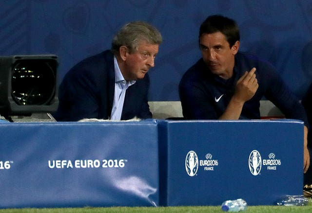 Gary Neville (right) also left his role as a coach following Hodgson's departure.
