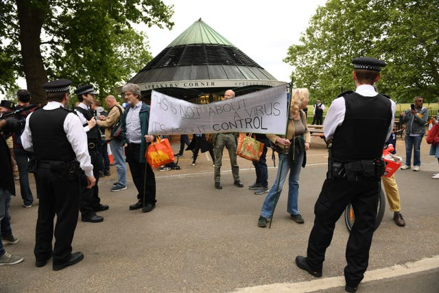 Police talk to protesters in Hyde Park
