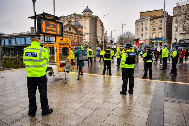 Police officers and Bristol Council Covid marshals meet in the city centre for a briefing during a day of action to reinforce coronavirus lockdown regulations at targeted locations around Bristol