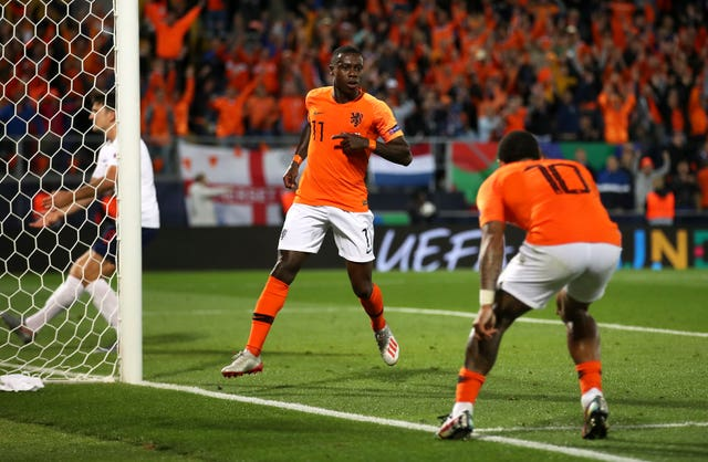 Netherlands' Quincy Promes (centre) celebrates scoring his side's third goal