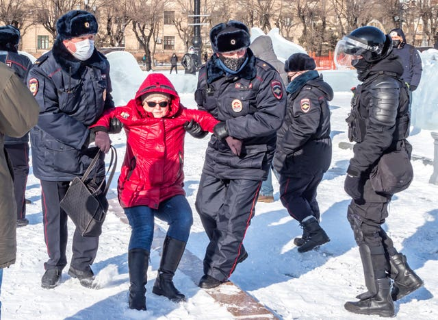 Police officers detain a woman during a protest in Khabarovsk, 6,100km (3,800 miles) east of Moscow