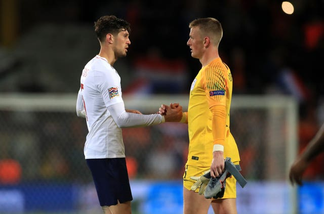 Stones and Pickford commiserate one another at full-time.