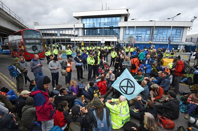 An Extinction Rebellion protest at London City Airport