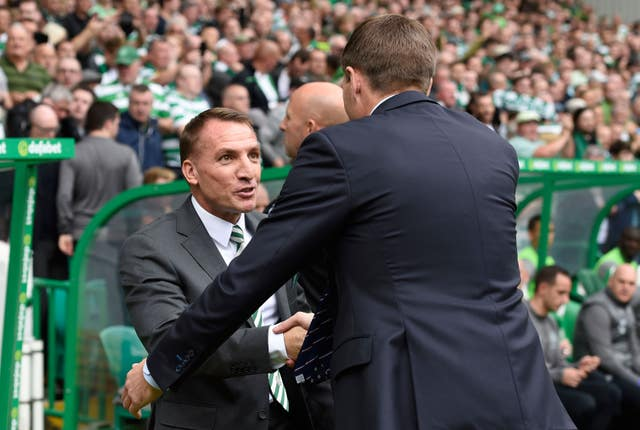 Steven Gerrard and Brendan Rodgers, left, shake hands before the match
