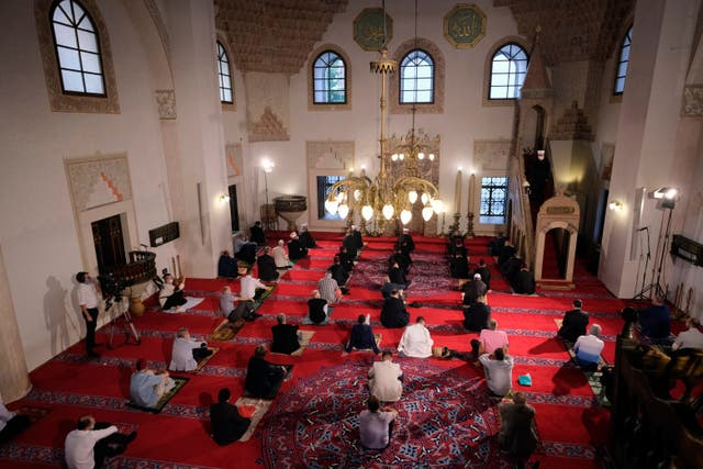Socially distancing worshippers wearing masks offer Eid al-Adha prayer at a mosque in Sarajevo, Bosnia