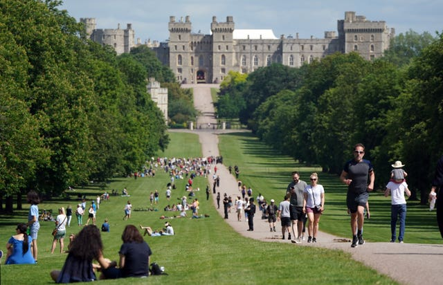 People make their way along the Long Walk in Windsor