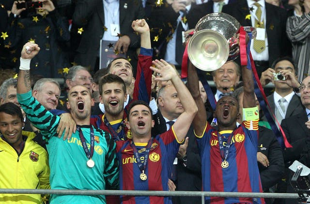 Xavi, centre, and Barcelona celebrate the Champions League trophy