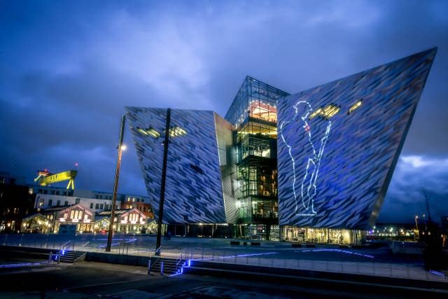 A First World War Tommy projected on to Titanic Belfast