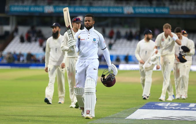 Shai Hope leads the players off after his twin hundreds clinched victory for the West Indies