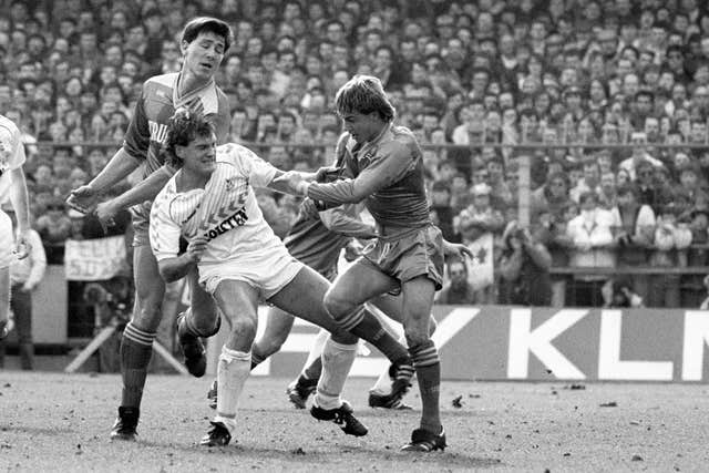 Glenn Hoddle was one of the many midfielders to go head-to-head against Wimbledon's Dennis Wise (right)