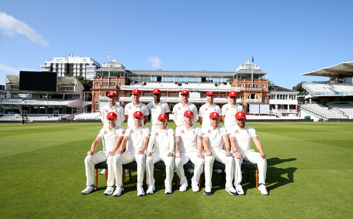 England pose for a team photo in their special edition red caps