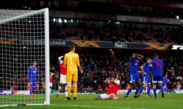 Aubameyang (centre) was left floored by a late miss which would have seen Arsenal through.