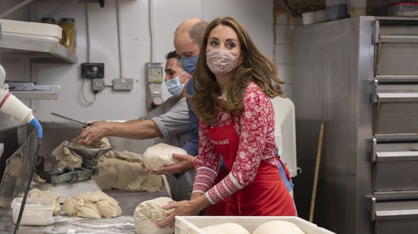 William and Kate visit bagel bakery on tour of London's East End