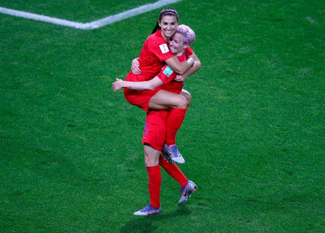 Alex Morgan celebrates her fifth goal with United States team-mate Megan Rapinoe, right