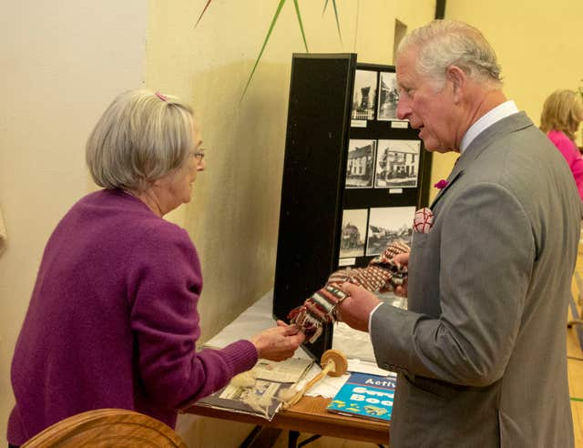 June Cochrane showed Charles a Viking-era sash (Steve Parsons/PA)