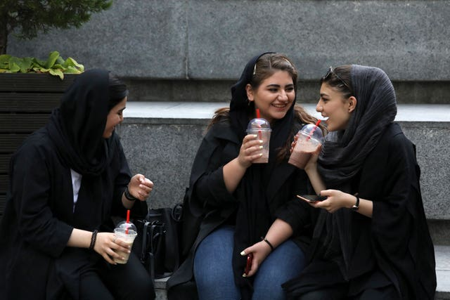 Youngsters outside a shopping centre in northern Tehran