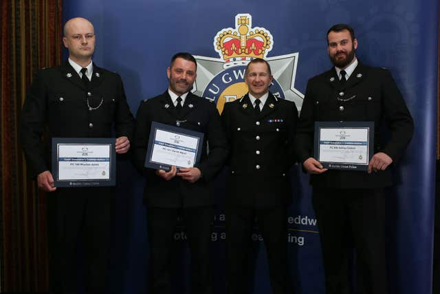 Chief Constable Julian Williams with Pc Rhydian Jones, Pc Gareth Marsh and Pc Ashley Cotton (Gwent Police/PA)