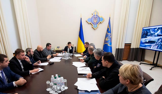 Ukrainian President Volodymyr Zelenskiy leads a meeting of the emergency response team on the crash of the Ukraine International Airlines plane in Iran
