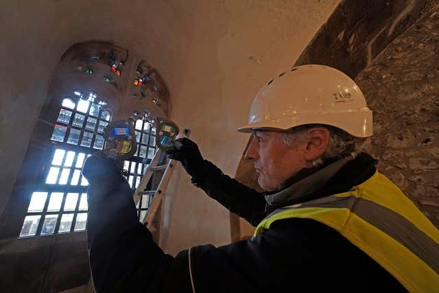 More jigsaw work on a stained glass window at the historic site (Owen Humphreys/PA)
