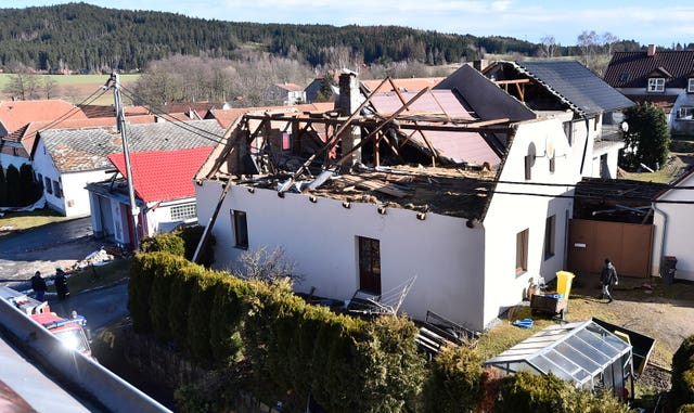 The roof of a house is damaged in Rohozna, Czech Republic