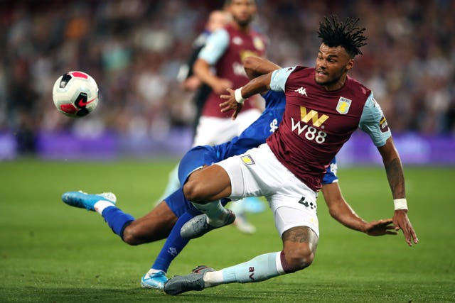 Tyrone Mings clears the ball against Everton