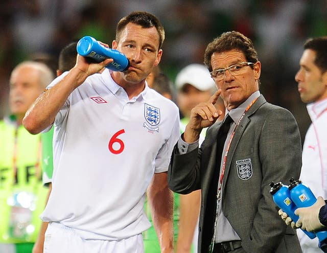 The decision to relieve Terry of the captaincy armband for a second time hastened the departure of Fabio Capello, right, as England manager (Owen Humphreys/PA)