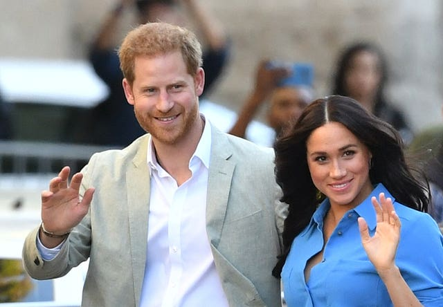 Harry and Meghan are now living in America are stepping down as working royals. Dominic Lipinski/PA Wire